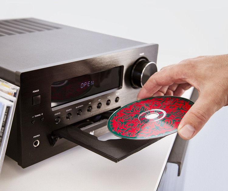 CD is inserted into an extended CD deck.