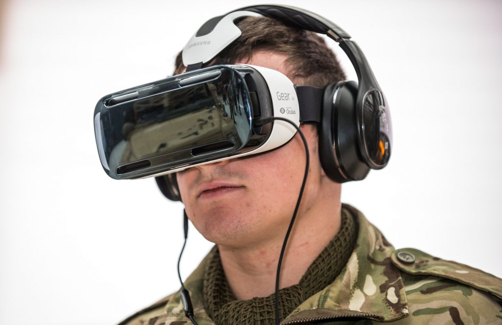 A Reservist soldier demonstrating a virtual reality headset.